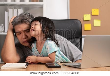 Asian Father Attempt To Work At The Home Office With A Laptop With A Daughter Who Came Into Chaos. N