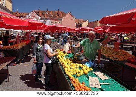 Zagreb, Croatia - June 30, 2019: People Visit Dolac Market Place In Zagreb, Capital City Of Croatia.