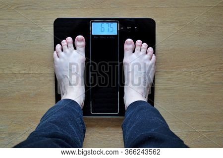 Lose Weight Concept With Person On A Scale Measuring Kilograms.