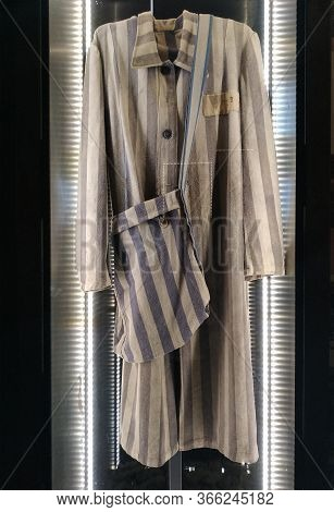 Walbrzych, Poland - 30.11.2019: Striped Prison Uniform, Robe, And Bag Of Holocaust Victims, Who Work