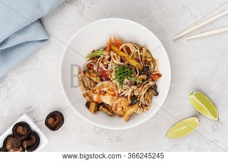 Wok Noodles With Chicken, Shrimp And Vegetables, Seasoned With Aromatic Thai Sauce. Food Delivery.