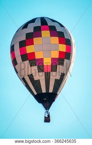 Hot Air Balloon Flying By In A Clear Blue Sky During An Airshow On A Summer Night In Battle Creek Mi