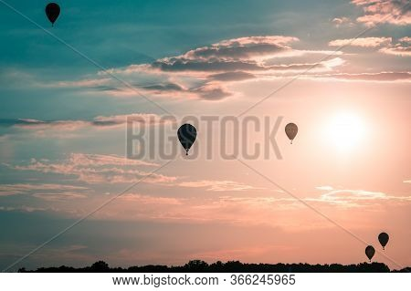Hot Air Balloons Floating Through The Air At Sunset At An Airshow In Battle Creek Michigan