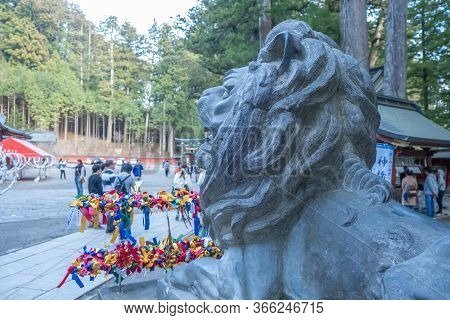 Tochigi, Japan - March 21, 2019: View Of Nikko Futarasan Jinja Lion At A Shinto Shrine In The City O