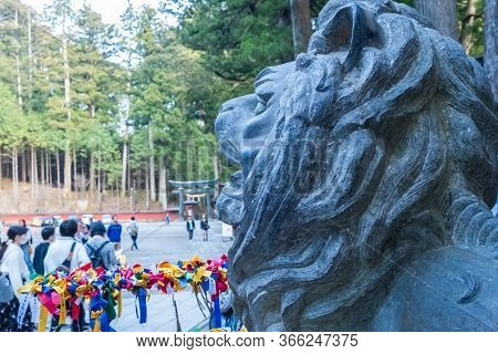 Tochigi, Japan - March 21, 2019: View Of Nikko Futarasan Jinja Lion At A Shinto Shrine In The City O