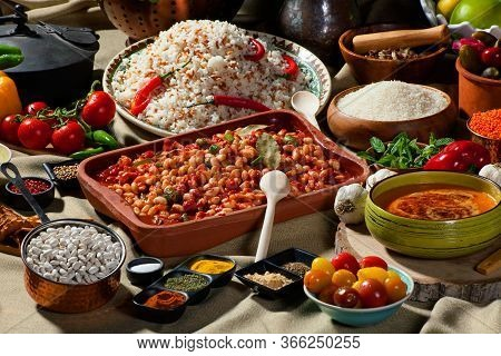 Cooked And Uncooked Haricot Beans, Served With Traditional Cooked Rice And Traditional Red Lentil So
