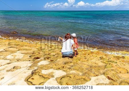 Oahu Island, Hawaii, United States - August 26, 2016: Tourist Woman With Child Looking Green Sea Tur