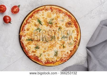 Classic Italian Pizza Margarita. Served On A Wooden Board. Food Delivery.
