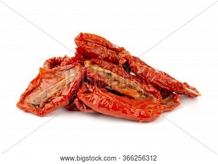 Dried Tomatoes On A White Background. Slices Of Dried Tomatoes In Oil Close Up.