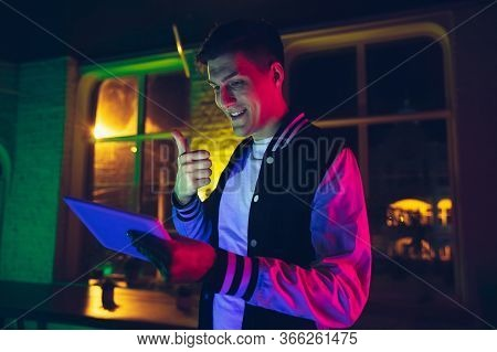 Thumb Up. Cinematic Portrait Of Stylish Man In Neon Lighted Interior. Toned Like Cinema Effects, Bri