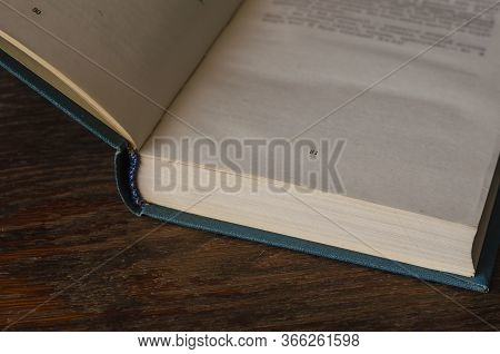 Open Book On A Wooden Table. The Hardcover Book Is Open On Page 31. Free Space For Text. Knowledge,