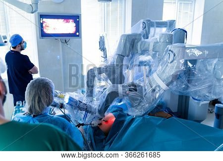 Robotic Surgery. Medical Team Performing Operation. Minimally Invasive Robotic Surgery.