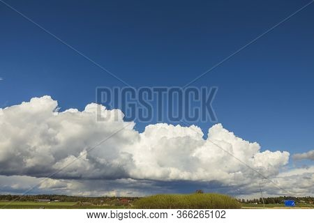 Gorgeous View Of Natural Landscape On A Summer Day. Forest, Blue Sky And Clouds Converging On The Ho