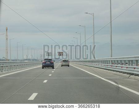 Cars Go On A New Wide Road Bridge. Kerch, Crimea - Jane 24, 2018