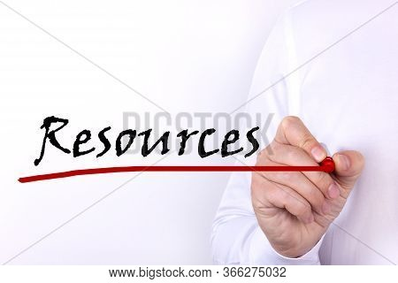 A Person Writes Text, A Word, The Phrase Resources With Marker On A Light Background. Business Conce