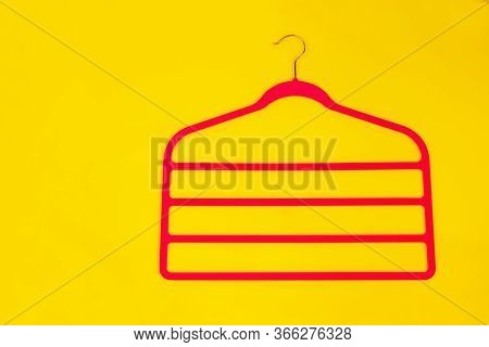 Multi-tier Hanger For Womens Clothing, Trousers On A Yellow Background.