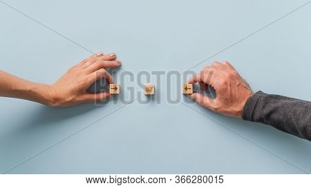 Online Shopping And Capitalism Conceptual Image - Male And Female Hand Holding Arrows Pointing Into