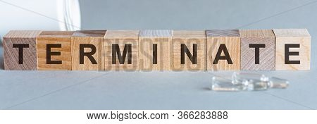 Terminate Word Written On Wood Block. Terminate Text On Wooden Table For Your Desing, Coronavirus Co