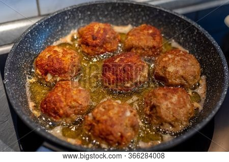 Raw Meat Cutlets Rissole Meatballs Of Minced Pork In A Pan.