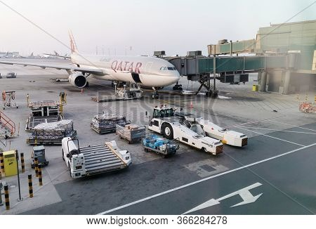 Doha, Qatar- March 7 2020: Airplanes Of Qatar Airways Parked On The Terminal Of Doha International A