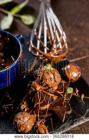 Chocolate Pralines And Pieces With Melted Chocolate
