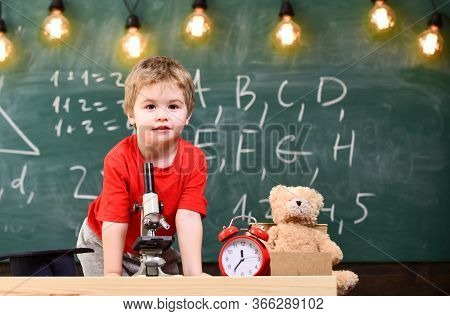 First Former Interested In Studying, Learning, Education. Primary School Concept. Kid Boy Near Micro