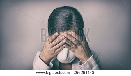COVID-19 Stress business woman crying covering face mask with hands Coronavirus employment recession anxiety.