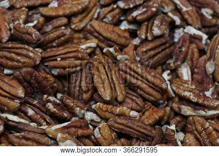 Lots Of Raw Organic Pecan Nuts. Pecan Background.
