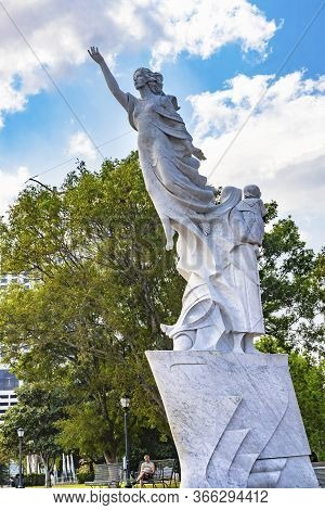 New Orleans, Louisiana, United States - October 6, 2019 Monument To Immigrant Statue Riverwalk Wolde