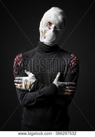 Strange Looking Injured Man In Black Turtleneck Sweater, His Head Wrapped Up With Bandages.