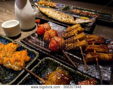Set Of Delicious Traditional Skewers Grilled For Dinner. Popular Japanese Variety Food In The Restau