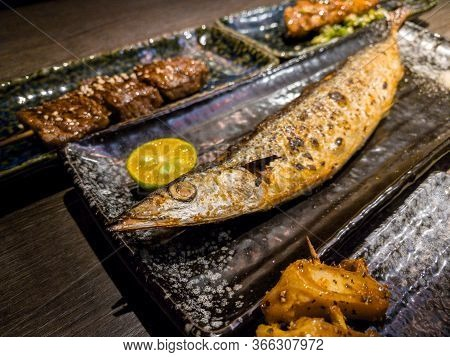 Set Of Delicious Traditional Skewers Grilled And Fish Dinner Restaurant.