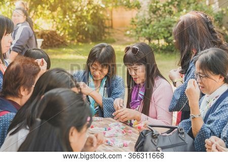 Lamphun Thailand - December 12 :  Unidentified Thai Female Tourists Learn To Make Tie-dye Clothes On