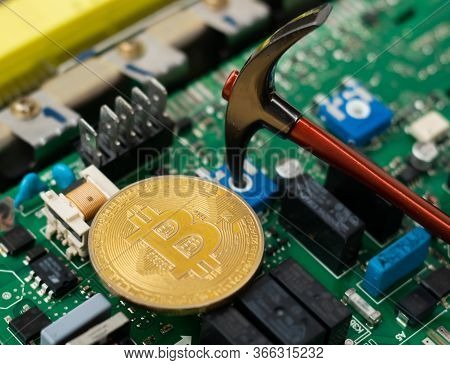 Bitcoin On Top Of Electronics Circuit Boards, Pickaxe Bitcoin Mining Concept