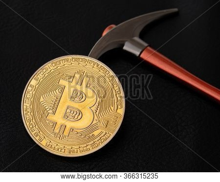 Btc Gold Coin On A Black Leather Background With Pickaxe