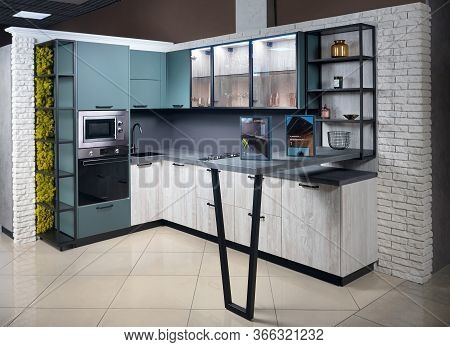 Grodno, Belarus - May 2020: Upscale Aqua Menthe Kitchen In Luxury Home With Breakfast Bar Counter Fl