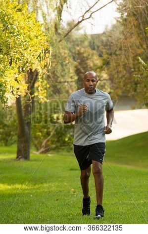 Mature Fit African American Man Running Outside.