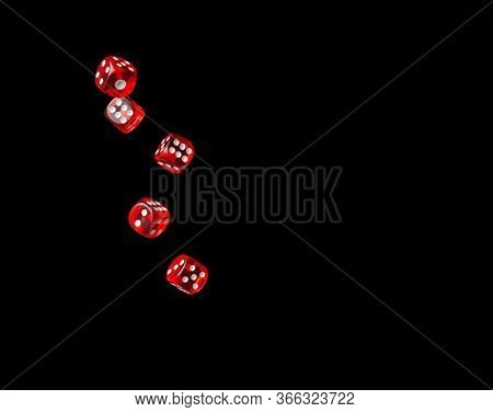 Dice In Air Isolated On Black Background.