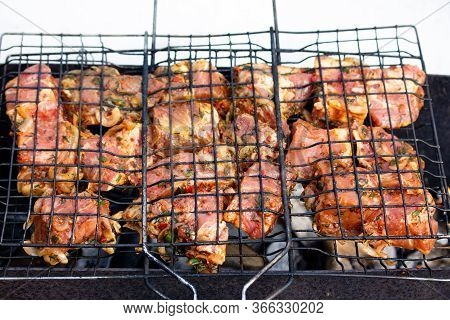 Raw Marinaded Juicy Pork Meat In Grill Grates. Fresh Food Prepared For Barbeque. Summer Cooking Outd