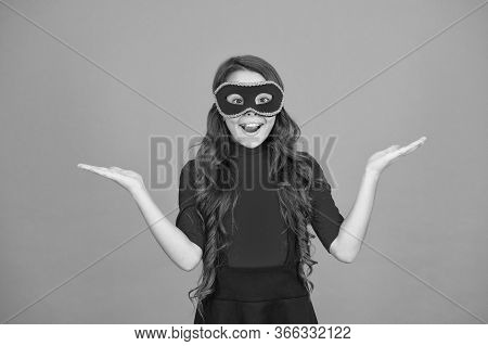 Product Advertising. Happy Girl In Carnival Mask Show Empty Hands For Product. Presenting Product. P