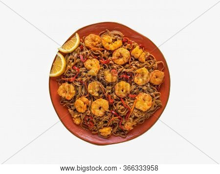 Isolated Stir-fried Noodles With Prawns And Vegetables, Top View.