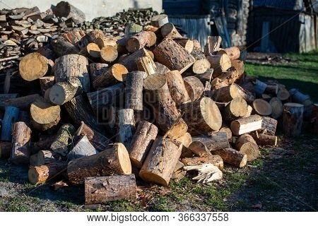 Firewood For Furnace Heating. Warehouse Firewood For Stove. Firewood Stacked And Prepared For Winter