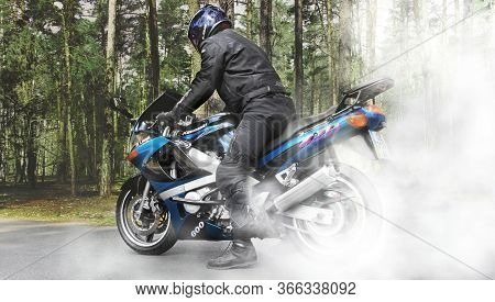 Chernihiv, Ukraine - April 7, 2020: A Motorcyclist On A Motorcycle On The Road. Burnout. Motorcycle