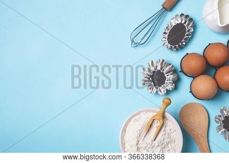 Baking Pastry Background, Ingredients, Kitchen Utensils On Light Blue Background, Flat Lay