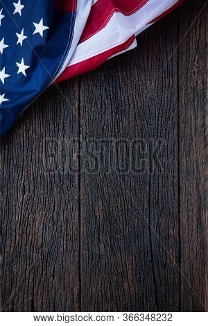 America Flag Waving Pattern On Wooden Background In Table Top View, Red Blue White Strip Concept For