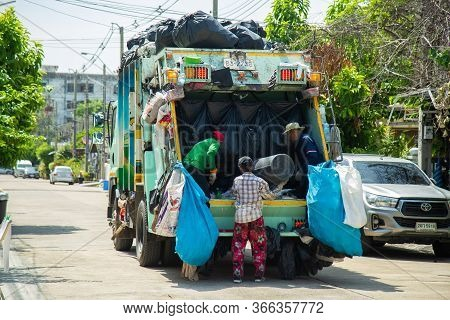 Nonthaburi, Thailand- May 15, 2020 : Local Garbage Collector Is Collecting Garbage Into The Garbage