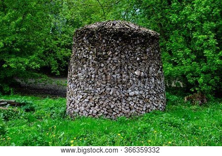 Chopped Wood In The Form Of A Pyramid. Dry Chopped Firewood Logs In A Pile Closeup