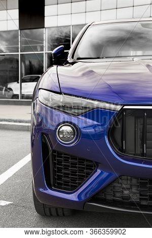 Part Of A Blue Car Close Up. Car Headlights. Luxury Headlights