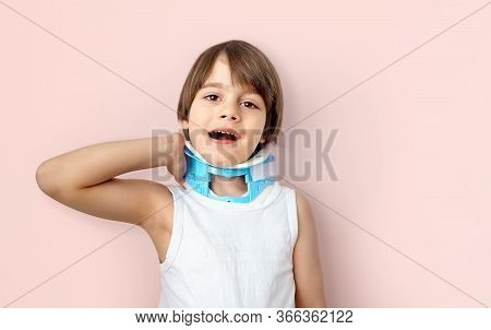 Little Boy Wearing Head Stabilizer Or Pediatric Cervical Collar Accusing Neck Pain (cervicalgia) And