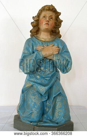 STITAR, CROATIA - SEPTEMBER 02, 2012: Angel, statue in Church of St. Matthew the Apostle and Evangelist in Stitar, Croatia